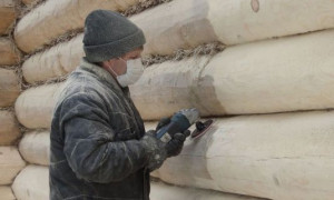 Как производится самостоятельная шлифовка деревянного сруба?