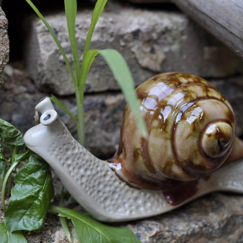 Садовый декор в виде улиток