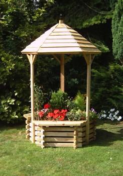 колодец с круглой деревянной крышей